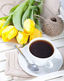 Morning coffee cup. On tray with yellow tulips stock photo