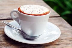 Morning Coffee. Cup of coffee in white cup on white plate Stock Photo
