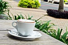 Morning Coffee. Cup of coffee in white cup on white plate Stock Images
