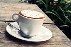 Morning Coffee. Cup of coffee in white cup on white plate Stock Photos