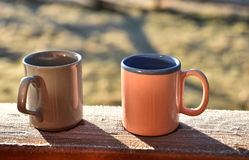 Morning coffee cups on a balcony Royalty Free Stock Images