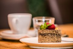 Morning coffee and delicious sweet baked cake with fruit stock photography