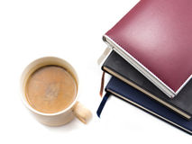 Morning coffee and diary. On white royalty free stock photo
