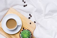 Morning Coffee and Diary with wooden pencil on cloth top view, woman creative Royalty Free Stock Photography