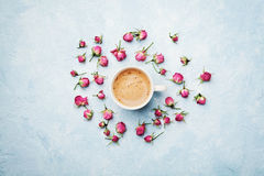 Morning coffee and dry rose flowers on blue vintage table top view in flat lay style. Cozy breakfast on Mother or Woman day. Morning coffee and dry rose flowers royalty free stock images