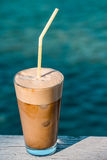 Morning coffee frappe by the sea. Royalty Free Stock Images