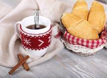 Morning coffee. Fresh croissants, shelves cinnamon Stock Photos
