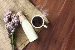 Morning Coffee. With fresh milk and flower on table Royalty Free Stock Photo