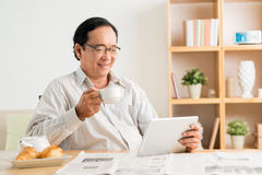 Morning coffee and fresh news Royalty Free Stock Image