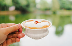 Morning coffee on hand. In garden Stock Image