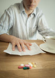 Morning coffee with a handful of pills. Royalty Free Stock Image