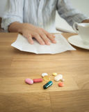 Morning coffee with a handful of pills. Stock Photo