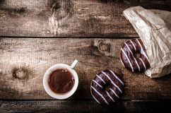 Morning - Coffee and homemade donuts filled with chocolate Royalty Free Stock Images