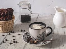 Morning coffee with ice cream, marshmallow in a basket and coffee beans Stock Photo