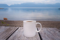Morning coffee by the lake Stock Photography