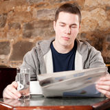 Morning coffee-man reading newspaper Royalty Free Stock Image
