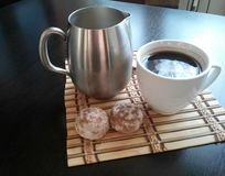 Morning coffee with milk. Coffee with milk in separate cup and two biscuit Stock Images