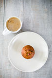 Morning coffee and muffin Stock Images