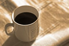 Morning coffee and news Royalty Free Stock Photos