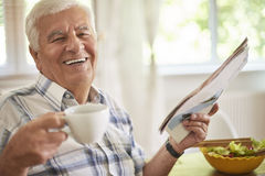 Morning coffee and newspaper Stock Photos