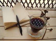 Morning Coffee and a notebook. Royalty Free Stock Images