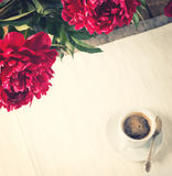 Morning coffee with peony flowers royalty free stock image