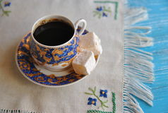 Morning coffee: porcelain cup with coffee and turkish delight Royalty Free Stock Photos