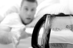 Morning Coffee Pot. Image of a man reaching for a pot of coffee from bed Stock Photography