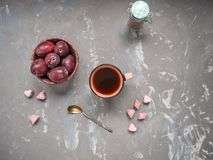 Morning coffee with red plums and pink sugar Royalty Free Stock Photo