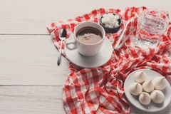 Morning coffee with treats on stylish checkered tablecloth on wh Stock Image