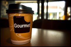 Morning Coffee Served in a Paper Cup on a Table.  Royalty Free Stock Photo