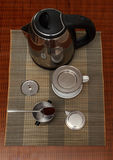 Morning coffee served in vietnam coffee filter on rattan table with two rattan chairs Royalty Free Stock Photos