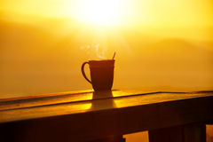 Morning coffee. Silhouettes on sunrise morning coffee Royalty Free Stock Images