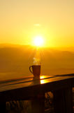 Morning coffee. Silhouettes on sunrise morning coffee Royalty Free Stock Photos