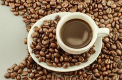 Morning coffee with stream and beans - vignette and vintage Royalty Free Stock Photos