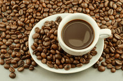 Morning coffee with stream and beans - vignette and vintage Royalty Free Stock Image