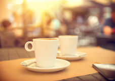 Morning coffee on the terrace in cafe Royalty Free Stock Photo