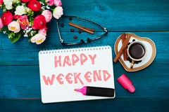 Morning coffee and text in notepad: Happy weekend Stock Photos
