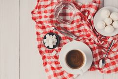 Morning coffee with treats on stylish checkered tablecloth on wh Stock Photo