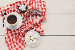 Morning coffee with treats on stylish checkered tablecloth on wh Royalty Free Stock Images