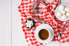 Morning coffee with treats on stylish checkered tablecloth on white background Royalty Free Stock Photos