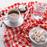 Morning coffee with treats on stylish checkered tablecloth on white background Royalty Free Stock Image