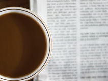 Morning coffee V. Reading the newspaper while having the morning coffee Royalty Free Stock Images