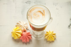 Morning coffee white background. White coffee and meringue on the table close up Stock Photos