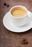 Morning coffee in a white cup. On a brown surface Stock Photo