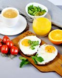 Morning Coffee White Cup Beverage Orange Juice Sandwich with Tasty Fried Egg. Morning Coffee. White Cup Beverage Orange Juice, Sandwich with Tasty Fried Egg Royalty Free Stock Photos