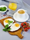 Morning Coffee White Cup Beverage Orange Juice Sandwich with Tasty Fried Egg. Morning Coffee. White Cup Beverage Orange Juice, Sandwich with Tasty Fried Egg Royalty Free Stock Image