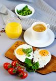 Morning Coffee White Cup Beverage Orange Juice Sandwich with Tasty Fried Egg. Morning Coffee. White Cup Beverage Orange Juice, Sandwich with Tasty Fried Egg Royalty Free Stock Images