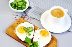 Morning Coffee White Cup Beverage Orange Juice Sandwich with Tasty Fried Egg. Morning Coffee. White Cup Beverage Orange Juice, Sandwich with Tasty Fried Egg Stock Photography