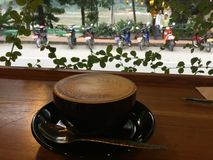 Morning Coffee on Wooden bar. cappuccino .Mekong river background. Laos. Cappuccino is a coffee drink that today is composed of double espresso and hot milk stock photography